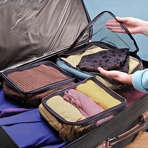 Como dobrar as roupas para arrumar mala de viagem
